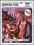 Postage stamp depicting the Madonna and Child With Two Angels issued by Burkina Faso.